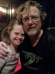 Sarah Gasper poses with bass player Stu  Hamm earlier this year at the Irving Theater.