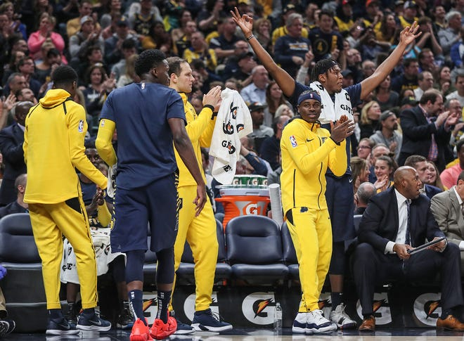 Indiana Pacers celebrate three points scored during the first half of the season opener at Banker's Life Fieldhouse in Indianapolis, Wednesday, Oct. 17, 2018.