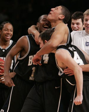 Butler's Brian Ligon, center, celebrates with Mike Green, left, and A.J. Graves after Butler defeated Gonzaga 79-71 for the NIT Tournament championship Nov. 24, 2006 at Madison Square Garden in New York.