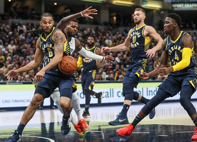 Indiana Pacers guard Cory Joseph (6) and Memphis Grizzlies guard Shelvin Mack (6), at left, knock the ball out of bounds while going for a rebound during the second half of the season opener at Banker's Life Fieldhouse in Indianapolis, Wednesday, Oct. 17, 2018.