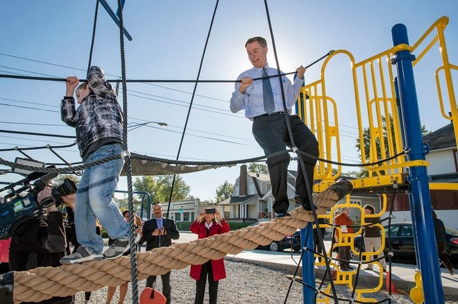 Indianapolis Mayor Joe Hogsett plays on Indy's newest neighborhood park, Commons Park, on Thursday, Oct 18, 2018. The quarter-acre property was once the site of the Outlaws Motorcycle Gang at 2204 E New York Street.