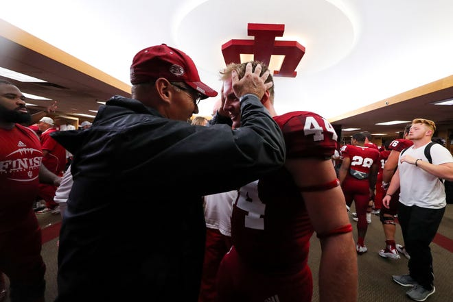 Hoosiers Coach Tom Allen and his son, linebacker Thomas Allen, celebrate after the Hoosiers beat Virginia earlier this year.