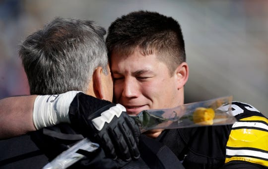 Iowa coach Kirk Ferentz, left, hugs his son, Iowa offensive linesman James Ferentz, during senior day ceremonies in 2012.