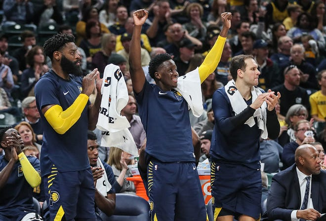 The Indiana Pacers celebrate their lead over the Memphis Grizzlies during the second half of the season opener at Banker's Life Fieldhouse in Indianapolis, Wednesday, Oct. 17, 2018.