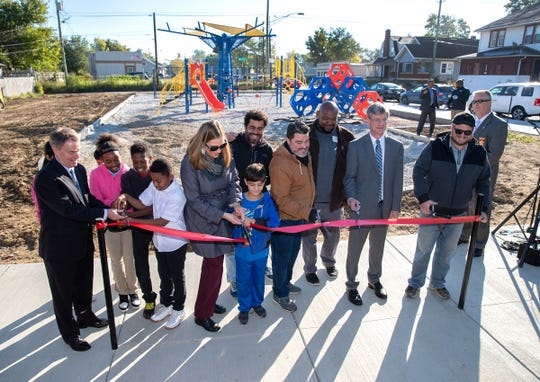 The official ribbon cutting of Indy's newest neighborhood park, Commons Park, on Thursday, Oct 18, 2018. The quarter-acre property was once the site of the Outlaws Motorcycle Gang at 2204 E New York Street.