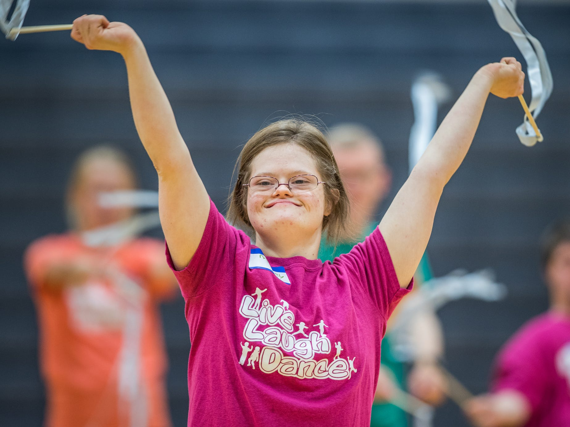 Mickey Deputy waves ribbons in preparation for an upcoming dance performance during Live Laugh Dance on Tuesday, July 10, 2018. The summer program, for young adults with Down syndrome, promotes movement and social interaction through dance. This is the eighth year of the program that was started by IUPUI.