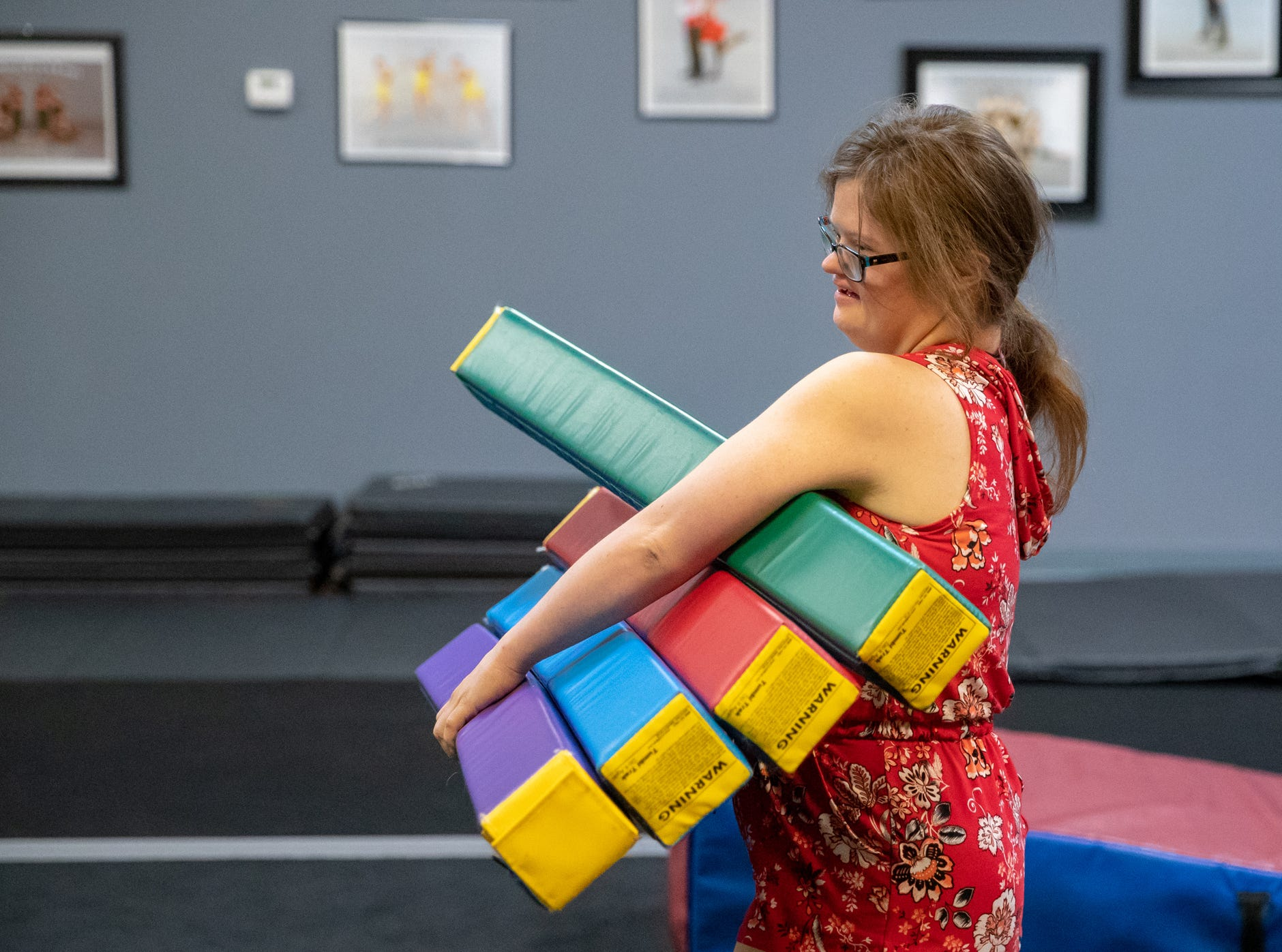 Mickey sets up for the obstacle course section of gymnastics class at Style Dance Academy in Franklin, Ind., on Tuesday, Oct. 9, 2018.