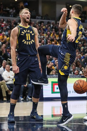 Indiana Pacers forward Domantas Sabonis (11) screams after Indiana Pacers forward Doug McDermott (20) slammed a dunk against then Memphis Grizzlies during the first half of the season opener at Banker's Life Fieldhouse in Indianapolis, Wednesday, Oct. 17, 2018.