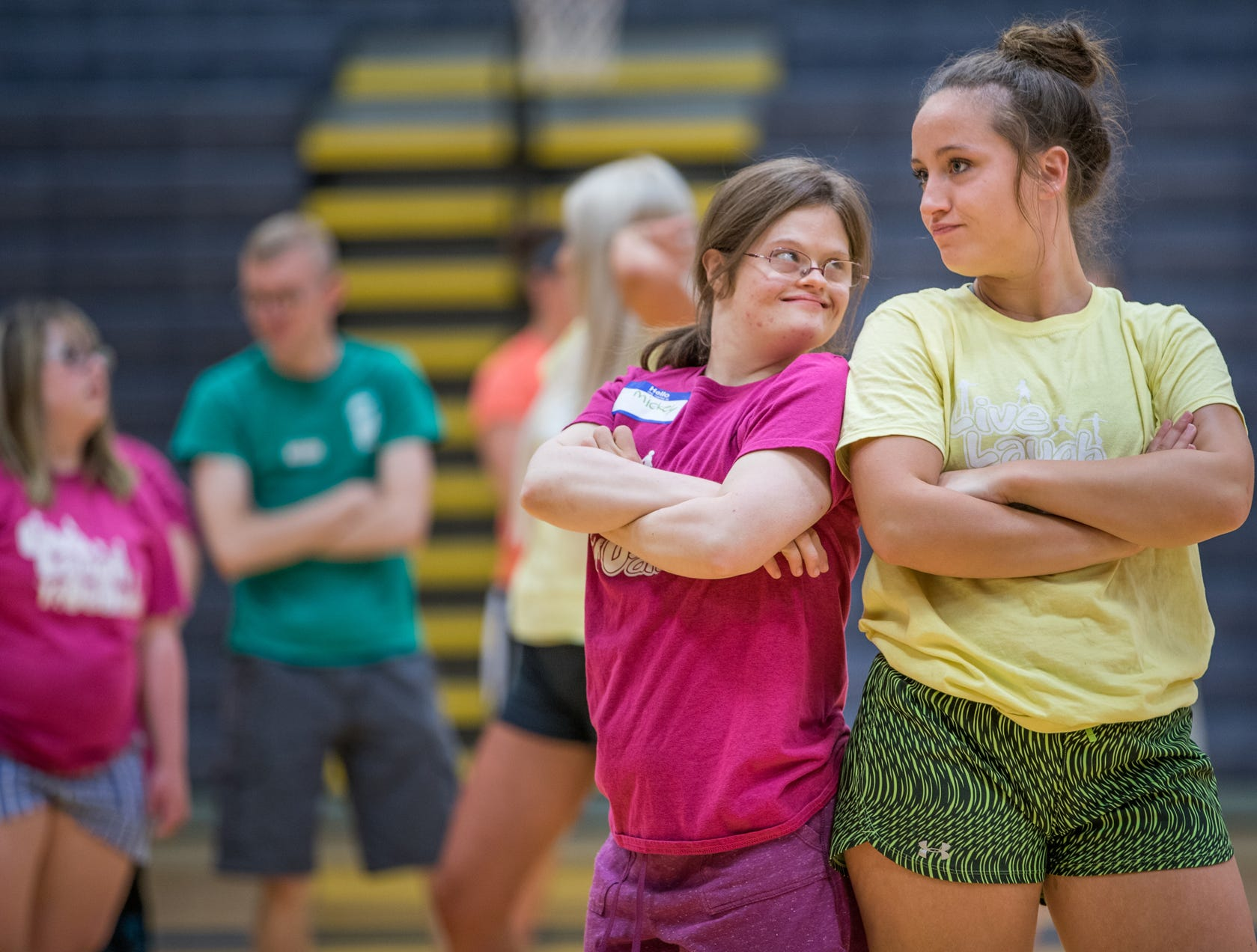 """Mickey Deputy (left) and her dance partner, Kelsey Edington, a volunteer, pose after a dance routine during Live Laugh Dance on Tuesday, July 10, 2018. """"She just has the biggest personality,"""" said Edington. """"She's super sassy and makes me laugh."""""""