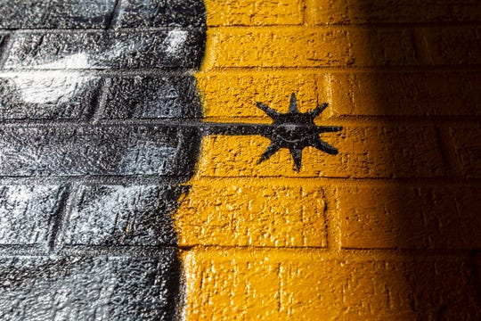 A mural painted by Thomas Agran is seen in an alley on Thursday, Oct. 18, 2018, outside MidWest One Bank in downtown Iowa City. Agran completed the mural in 2017.