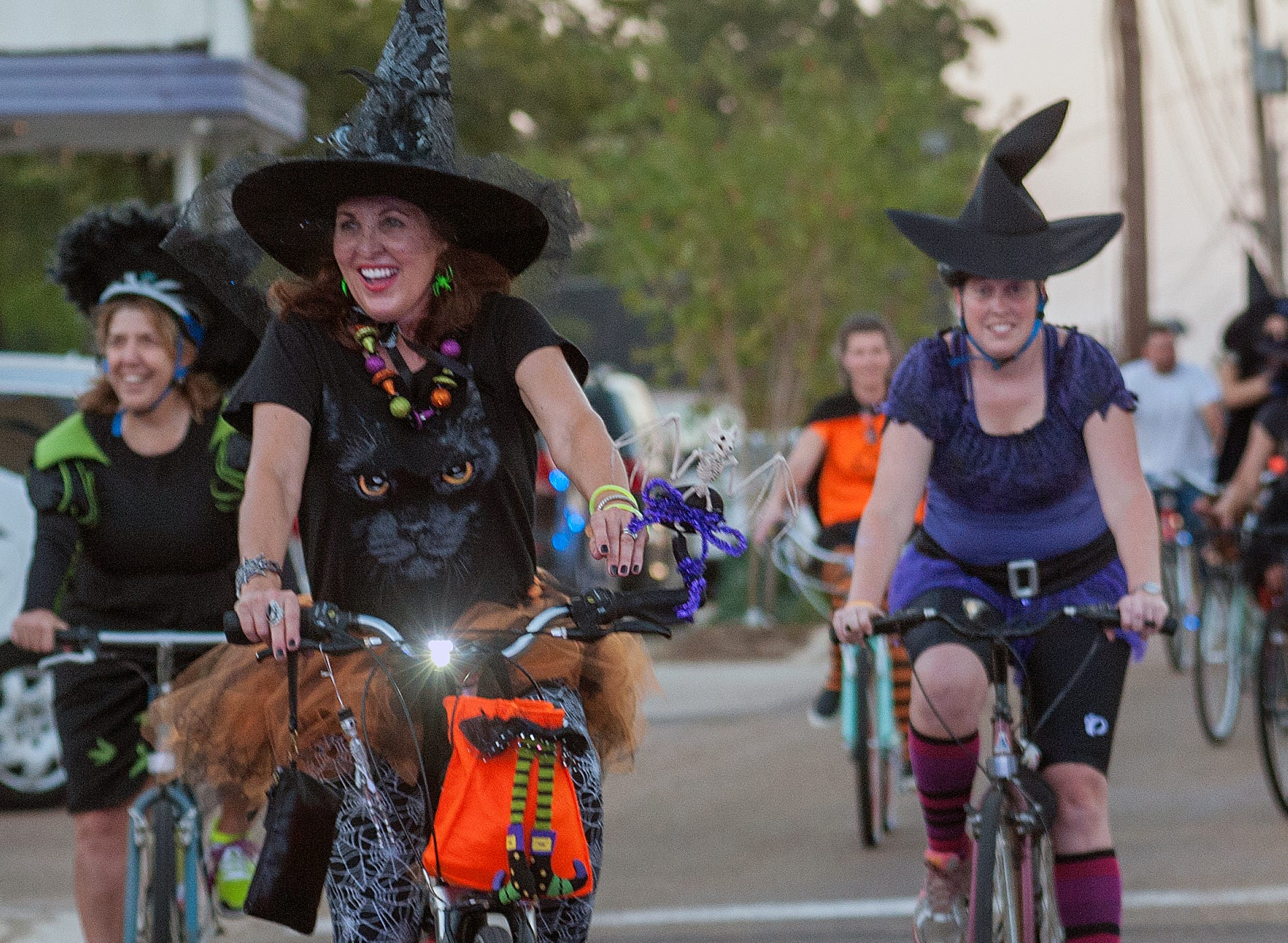 Witches fly south on bicycles along State Street in the Fondren District of Jackson resently during the Witches Ride as part of Fondren After Five events in support of the nonprofit Extra Table.