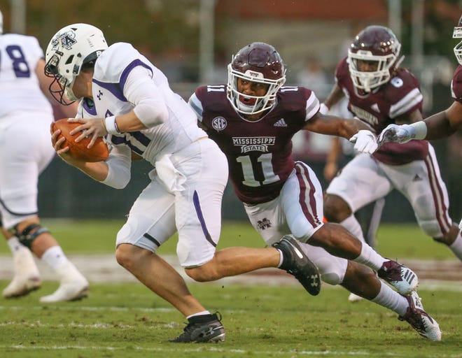Mississippi State's Jaquarius Landrews (11) wraps up Stephen F. Austin's Josh Covey (11). Landrews got the first start of his Mississippi State career against Auburn on Oct. 6. Photo by Keith Warren/Mandatory Credit