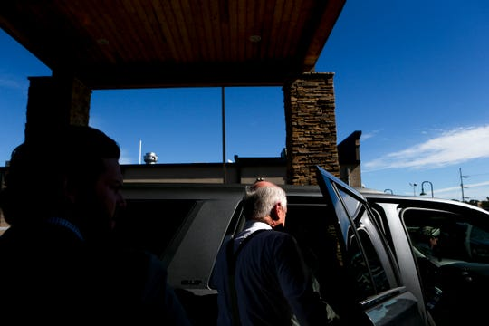 Democratic candidate for Senate former Gov Phil Bredesen places his jacket in his campaign car before getting inside and heading to another stop at a candidate forum hosted by the West Tennessee Development Caucus at Country Inn & Suites in Jackson, Tenn., on Thursday, Oct. 18, 2018.