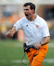 Tennessee head coach Derek Dooley cheers on Tennessee tailback Marlin Lane Jr. as he picks up yards against Cincinnati at Neyland Stadium Saturday, Sept. 10, 2011. Tennessee won the game 45-23. (AMY SMOTHERMAN BURGESS)