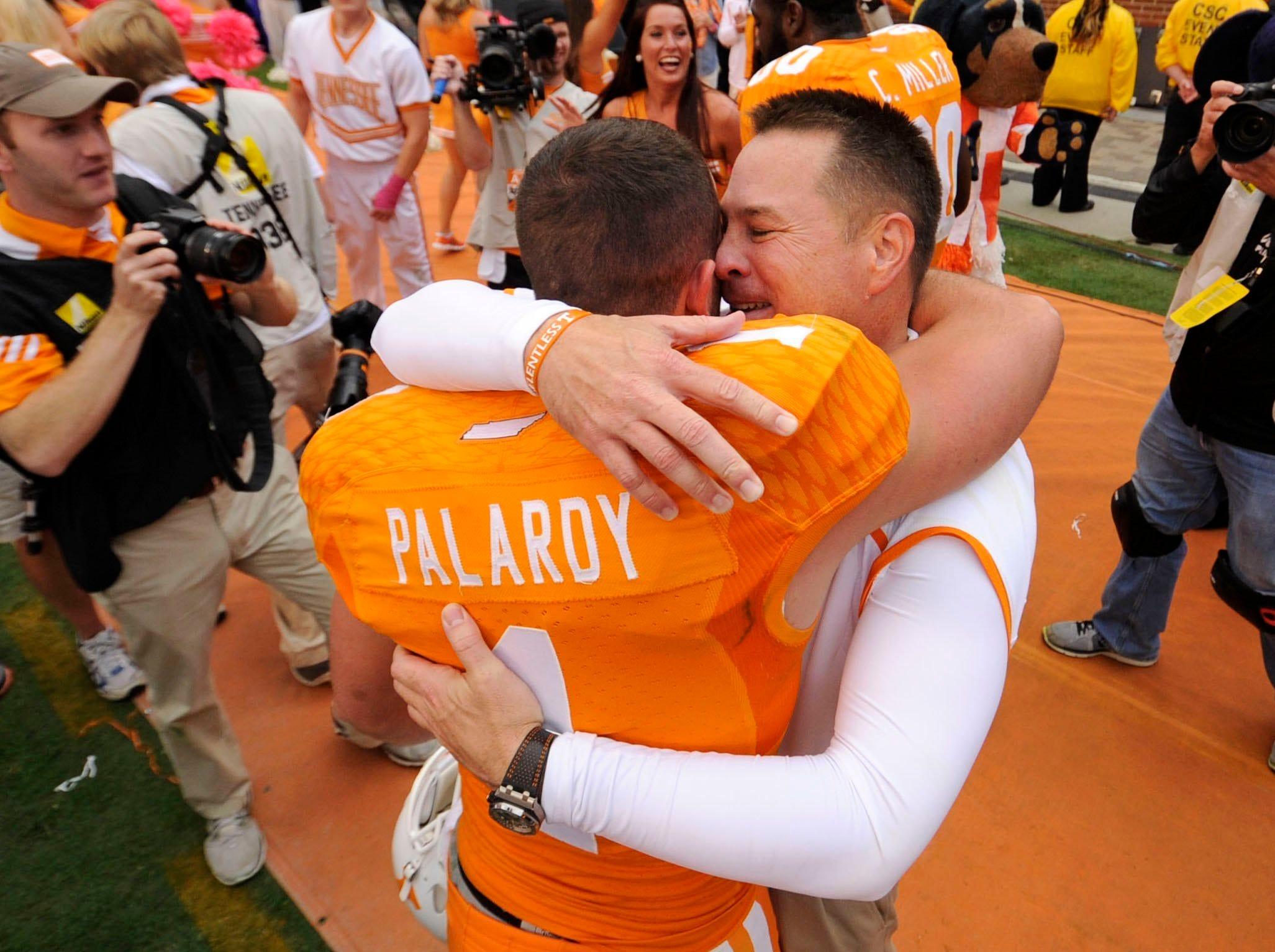 Tennessee placekicker Michael Palardy (1) hugs Tennessee head coach Butch Jones after Tennessee beat South Carolina 23-21 at Neyland Stadium in Knoxville on Saturday, Oct. 19, 2013. (ADAM LAU/NEWS SENTINEL)