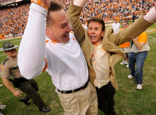 Tennessee head coach Butch Jones celebrates with Athletic Director Dave Hart after Tennessee beat South Carolina 23-21 at Neyland Stadium in Knoxville on Saturday, Oct. 19, 2013. (ADAM LAU/NEWS SENTINEL)