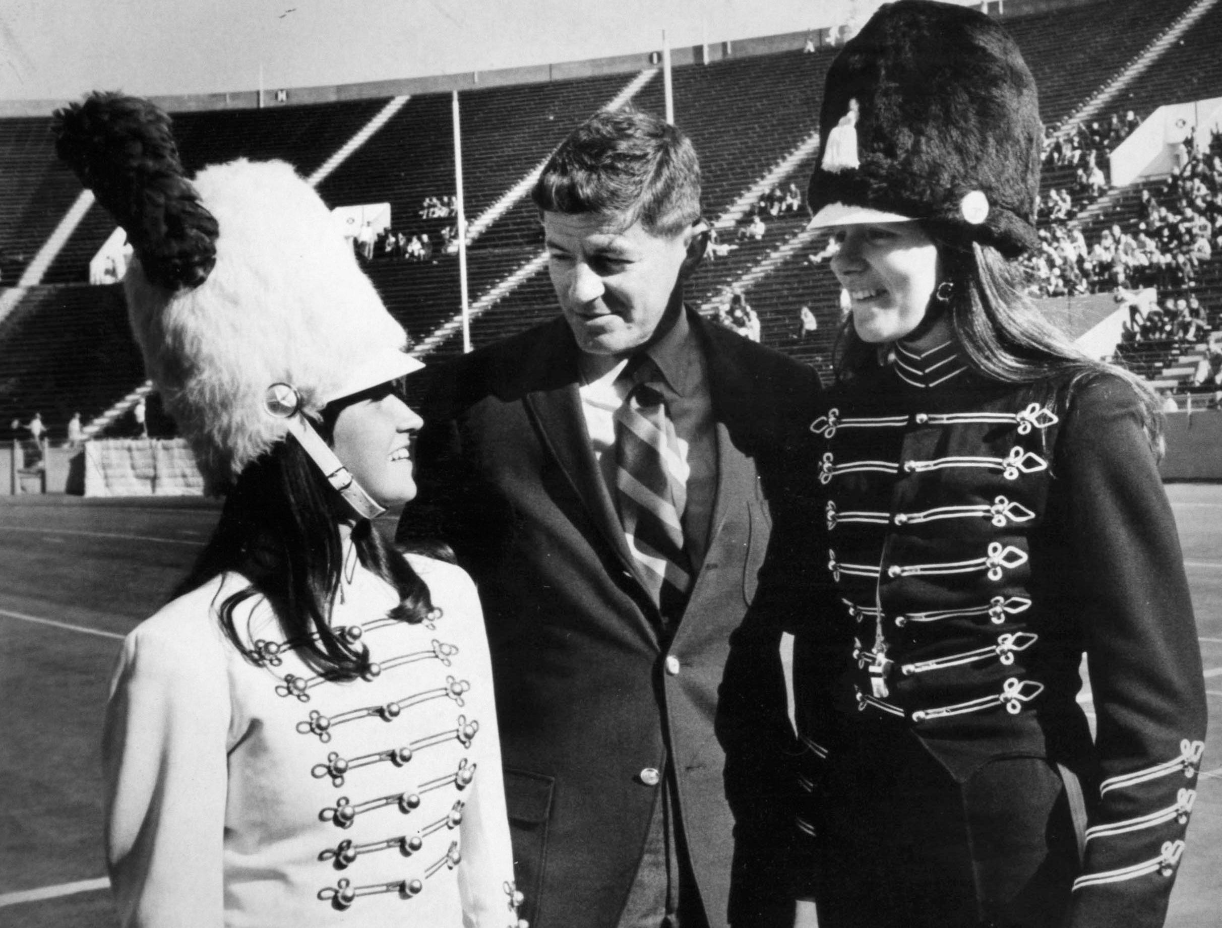 University of Tennessee Pride of the Southland Band Director Dr. W. J. Julian talks with Patsy Malone, left, drum majorette of Two Rivers High School, Nashville, and Susan Freedman, head majorette of Lenoir City High School, on Oct. 27, 1968, at Neyland Stadium. Julian was congratulating the majorettes on their bands' victories in the UT Band Festival.
