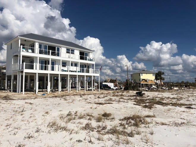 Russell King's house stands in Mexico Beach mostly unharmed by Hurricane Michael, a storm which is estimated to have caused $25 billion in damage.
