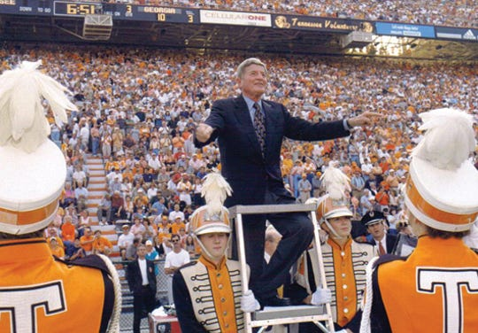 "Dr. W.J. Julian, director of the Pride of the Southland Marching Band from 1961 to 1993, directs the band. Thsi photo is part of the new book ""History of the University of Tennessee's Pride of the Southland Marching Band"" by UT band alumni and Knoxvillian Larry Murphy. Proceeds from the book sales go to the band program's scholarship fund."