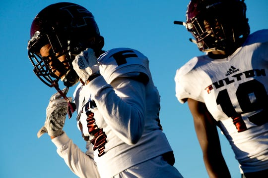 Fulton's Adrian Roberson (14) and Fulton's Elijah Davis (19) warm up during a football game between West and Fulton at West High School in Knoxville, Tennessee on Thursday, October 18, 2018.