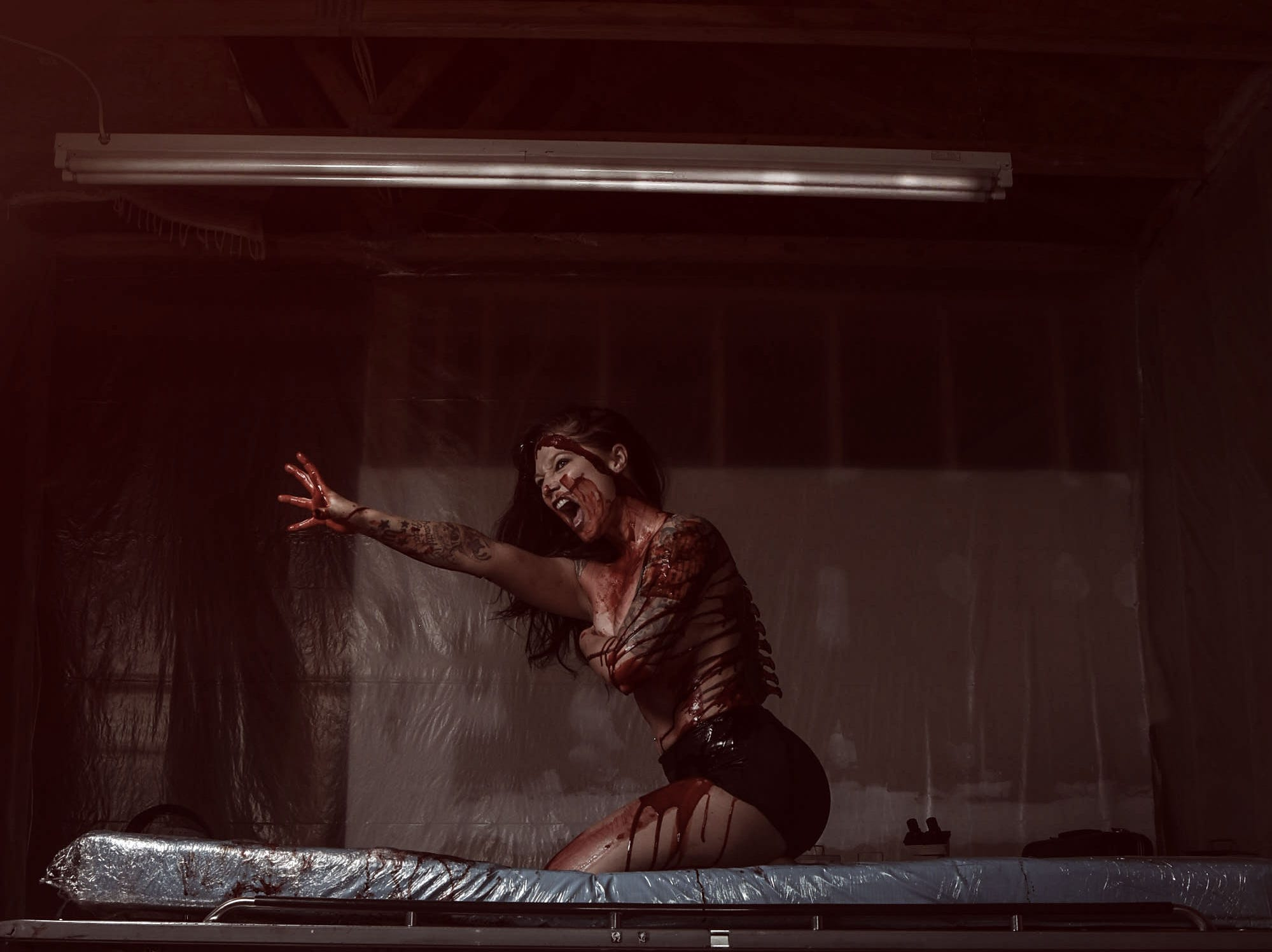 Leighann Word portrays a victim in this horror-themed photo session by Mallory Bertrand. Special effects are by Ash Mac.