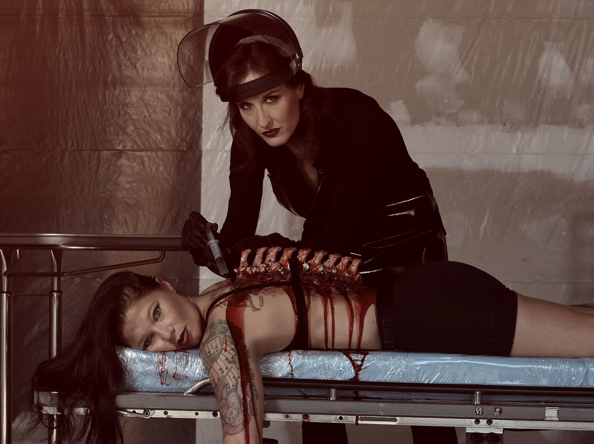 Lori Cannon as the mad physician and Leighann Word as the victim in Mallory Bertrand's horror-inspired photo series