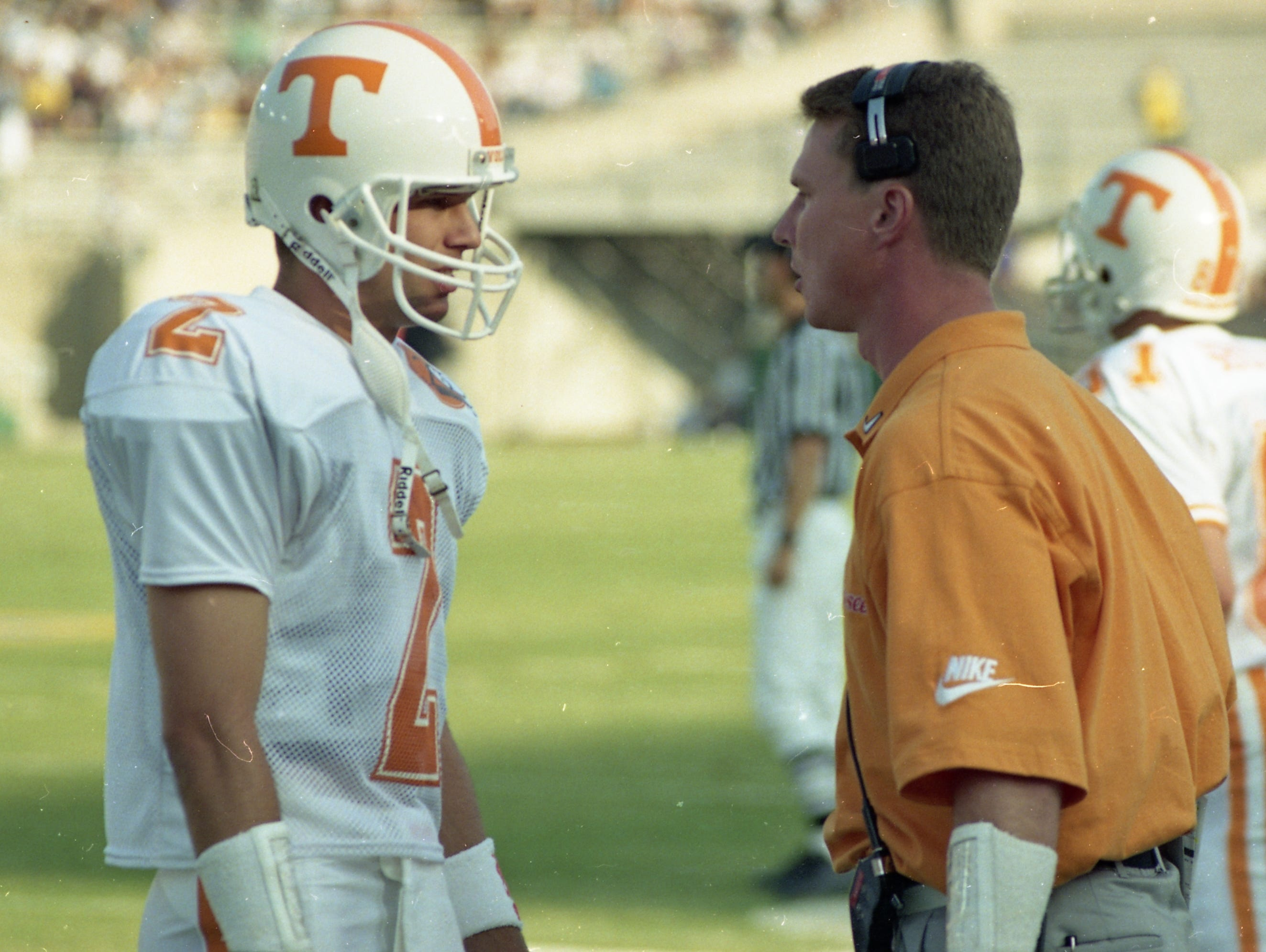 Todd Helton gets instructions from the quarterback coach before going on the field to replace injured Jerry Colquitt on September 4, 1994.