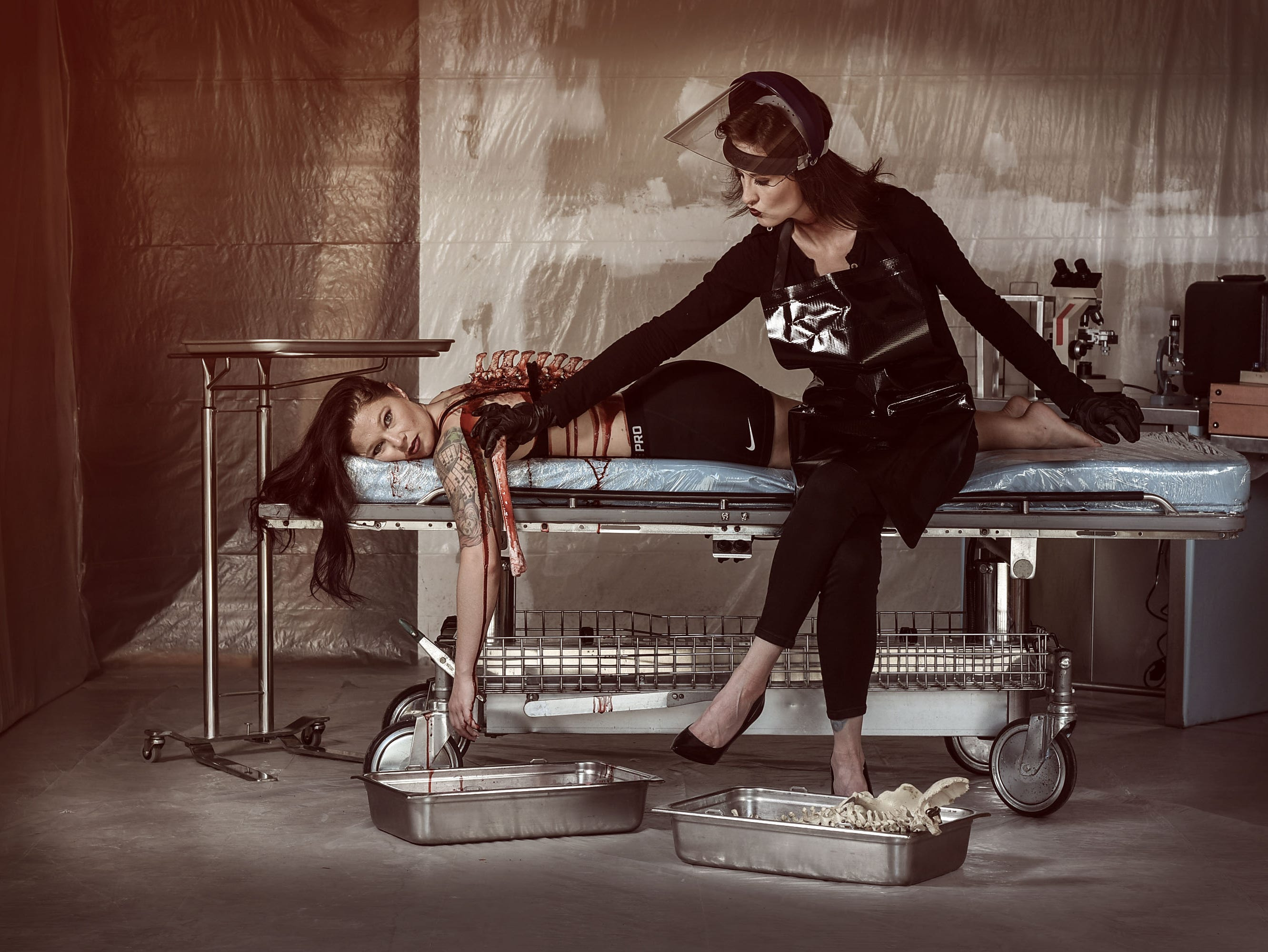 Lori Cannon as the physician with Leighann Word as the victim in this horror-themed photo session by Mallory Bertrand. Special effects by Ash Mac.