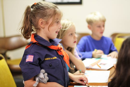 Amelia Houston learns about birds in a Tigers Den meeting on Oct. 15.