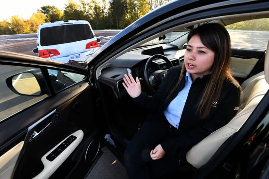 Denso engineer and driver Amanda Dango just before a demonstration of this 2016 Lexus RX equipped with its Advanced Driver-Assistance System (ADAS) technology Thursday, Oct. 18, 2018 at one of their Alcoa plants.