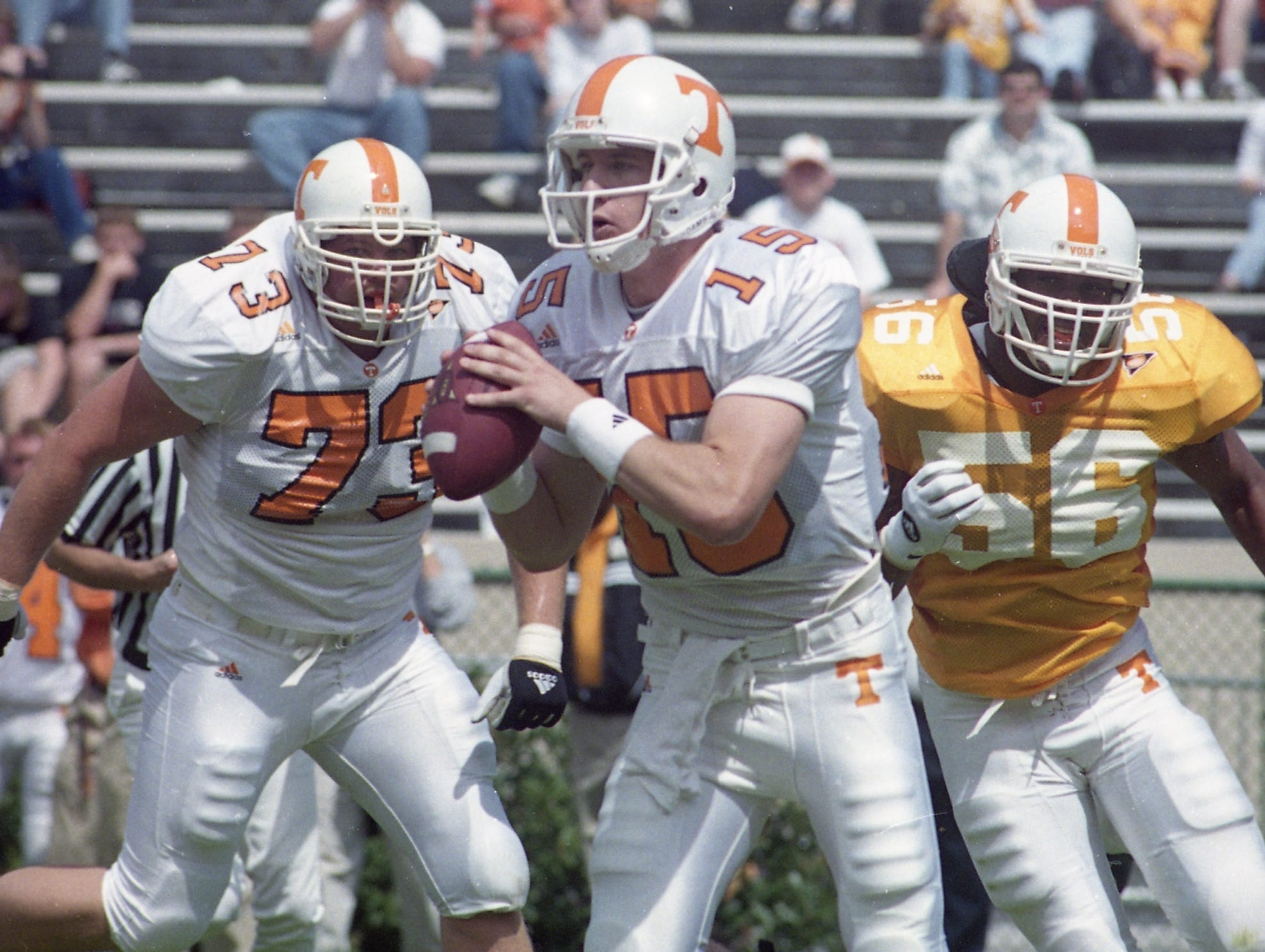 Tennessee quarterback AJ Suggs, 15, looks for an opening as Bernad Jackson, 56, is coming in from behind on April 16, 2000. Will Ofenheusle, 73, tries to run in to block.