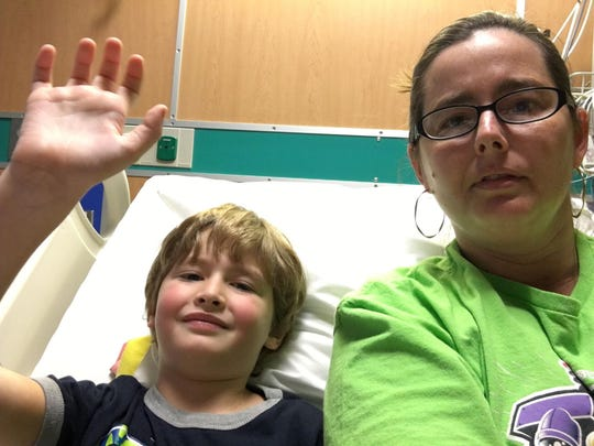 Serena Hill, right, and her 6-year-old son Spencer, who is hospitalized with acute flaccid myelitis. The CDC warned this week that the rare disease is on the rise, especially among children.