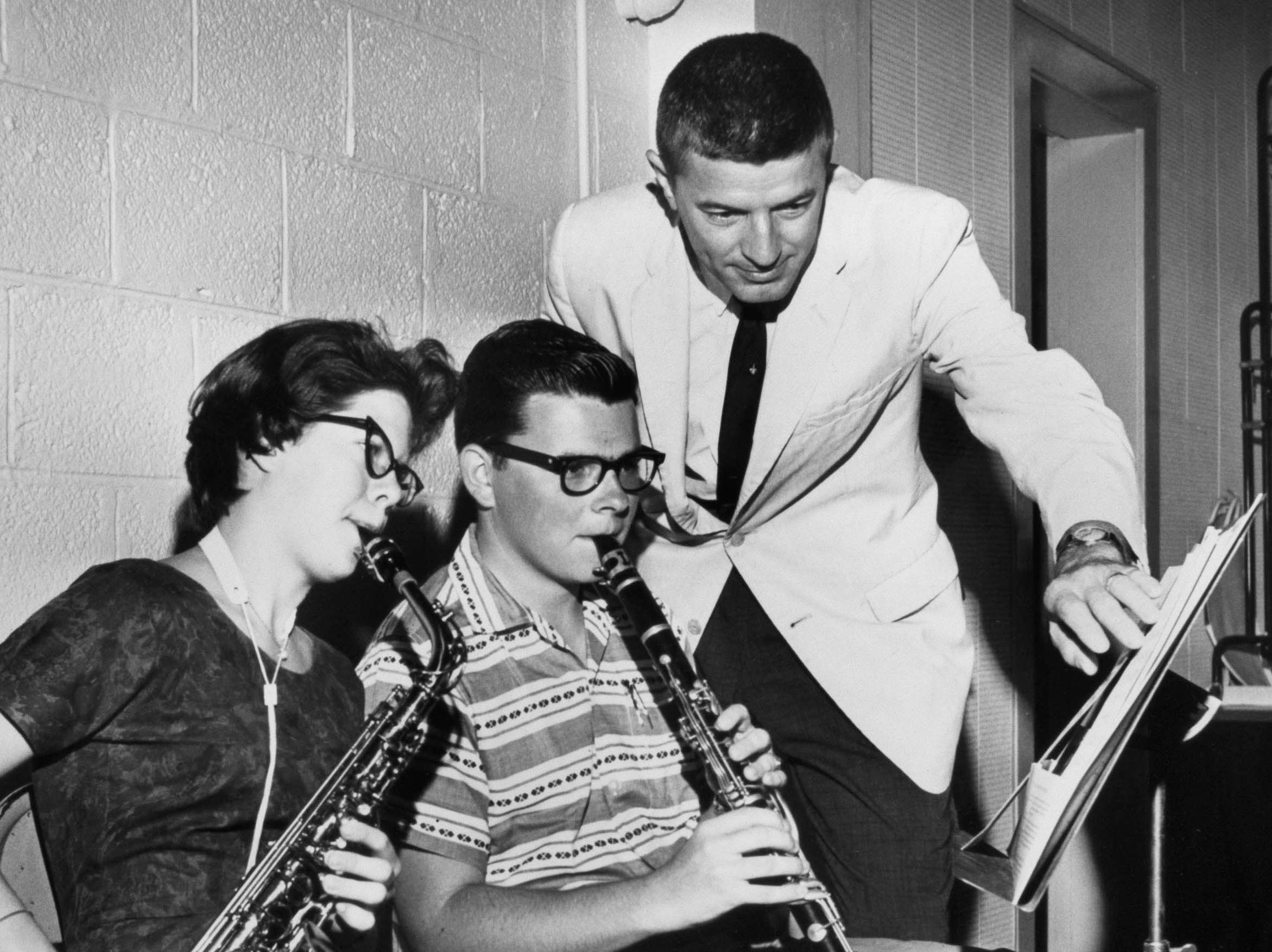 University of Tennessee Pride of the Southland Band Director Dr. W. J. Julian poses for a photo on July 25, 1961, with Edna Mantz of Clinton High School and Joe McNew of Young High School.