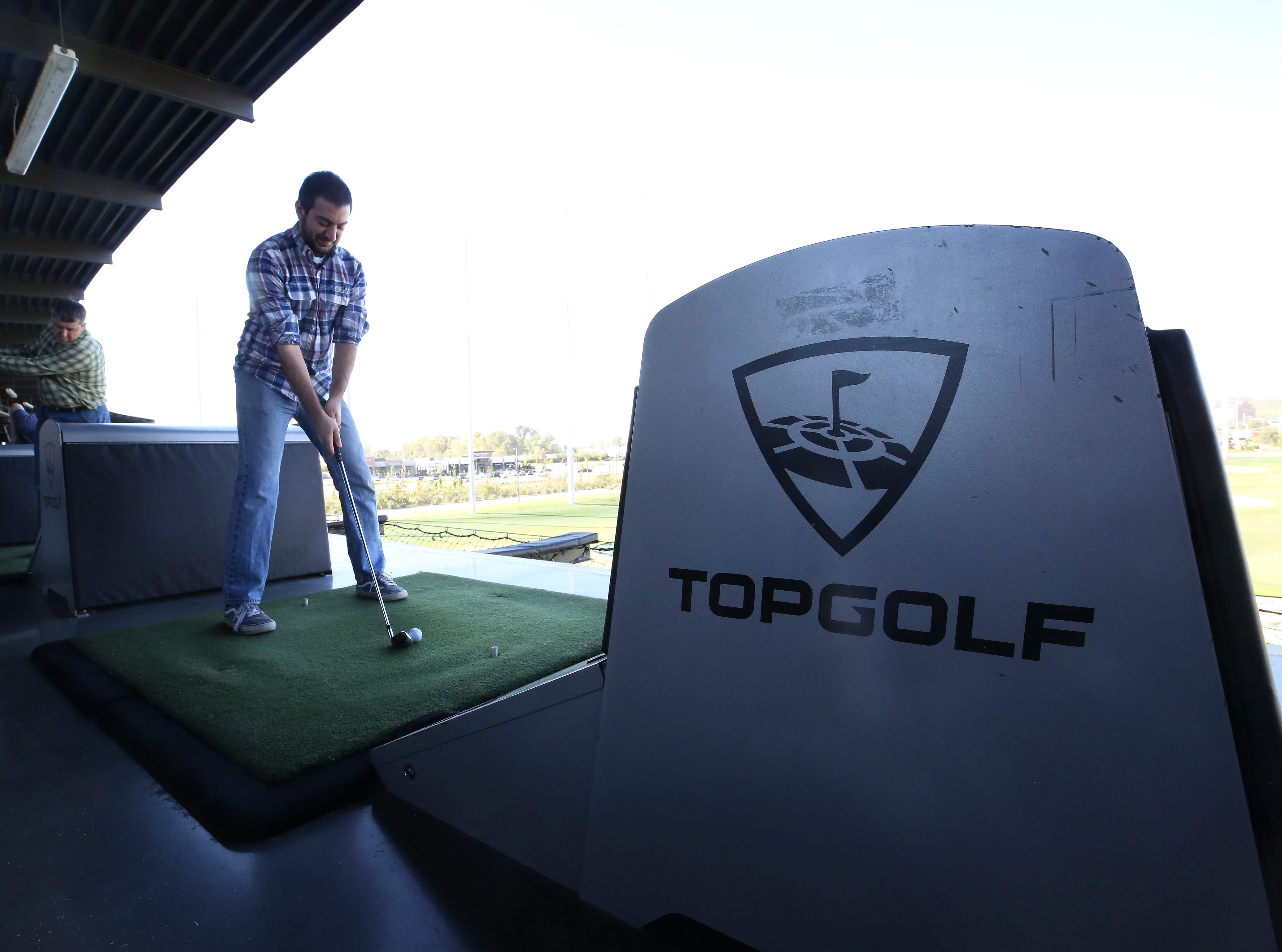 Courier Journal reporter Justin Sayers worked on his swing at the Topgolf outside of Cincinnati, Ohio.  Topgolf is proposing to build a facility at the Oxmoor Center in Louisville as they wait for a decision by the Louisville Metro Planning Commission. 