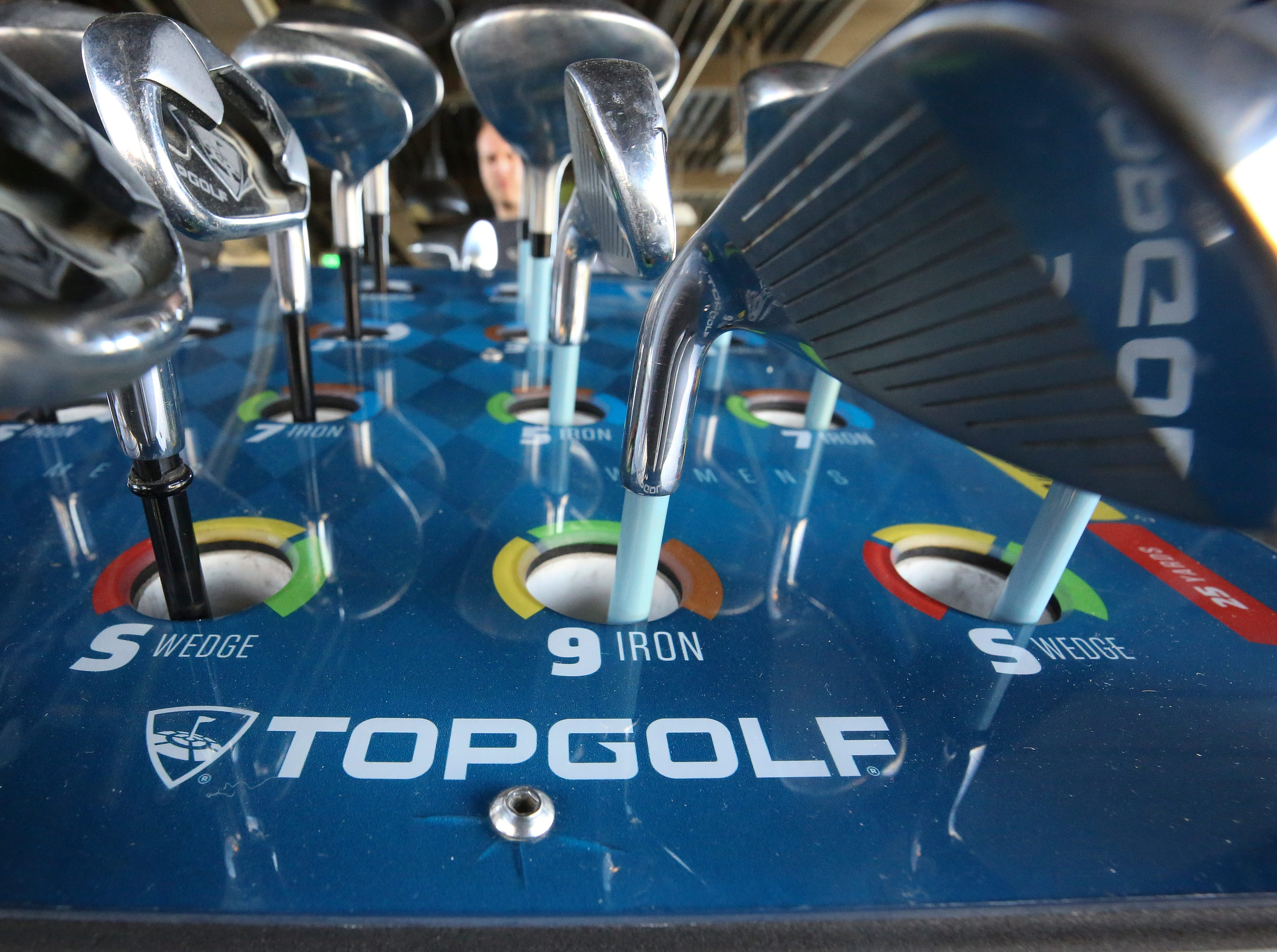 Golf clubs at the Topgolf outside of Cincinnati, Ohio.  Topgolf is proposing to build a facility at the Oxmoor Center in Louisville as they wait for a decision by the Metro planning commission. 