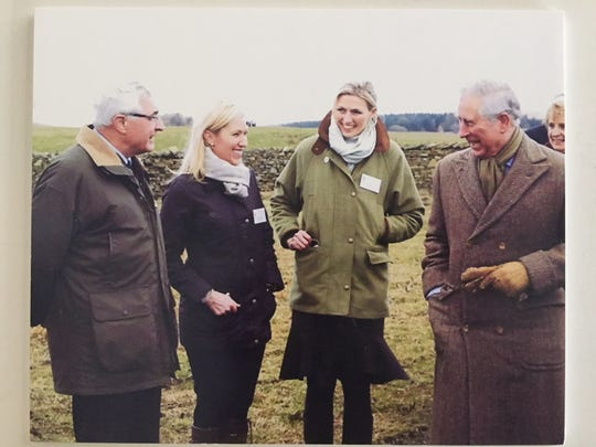 Laura Schwab, second from left, hangs out with Prince Charles, far right, back when she worked for Jaguar Land Rover.