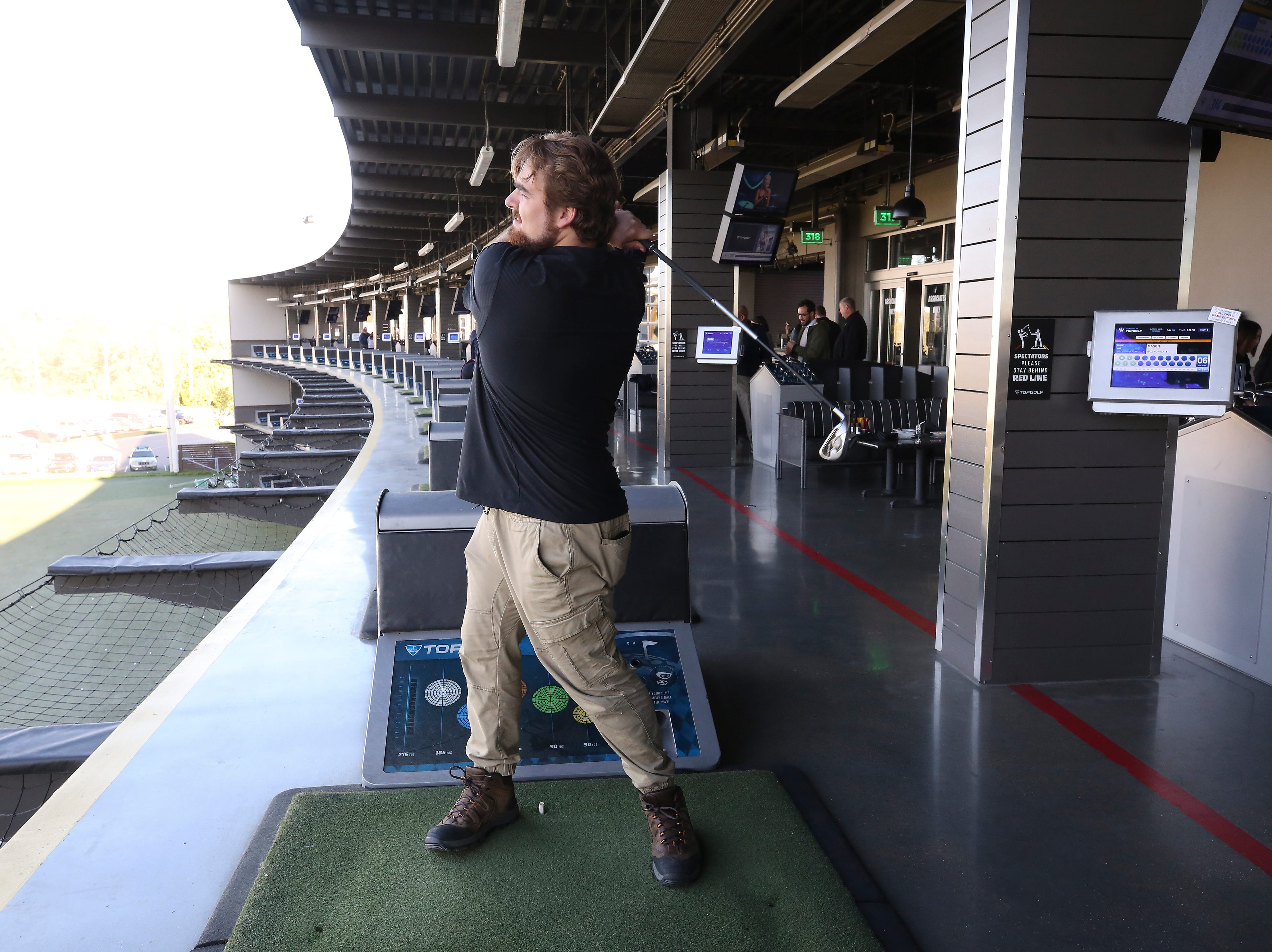 Mason Nowels watched his ball fly at the Topgolf outside of Cincinnati, Ohio.  Topgolf is proposing to build a facility at the Oxmoor Center in Louisville as they wait for a decision by the Metro planning commission. 