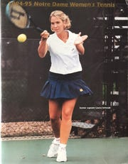 Laura Schwab makes the cover of Notre Dame's tennis yearbook as the team's captain.
