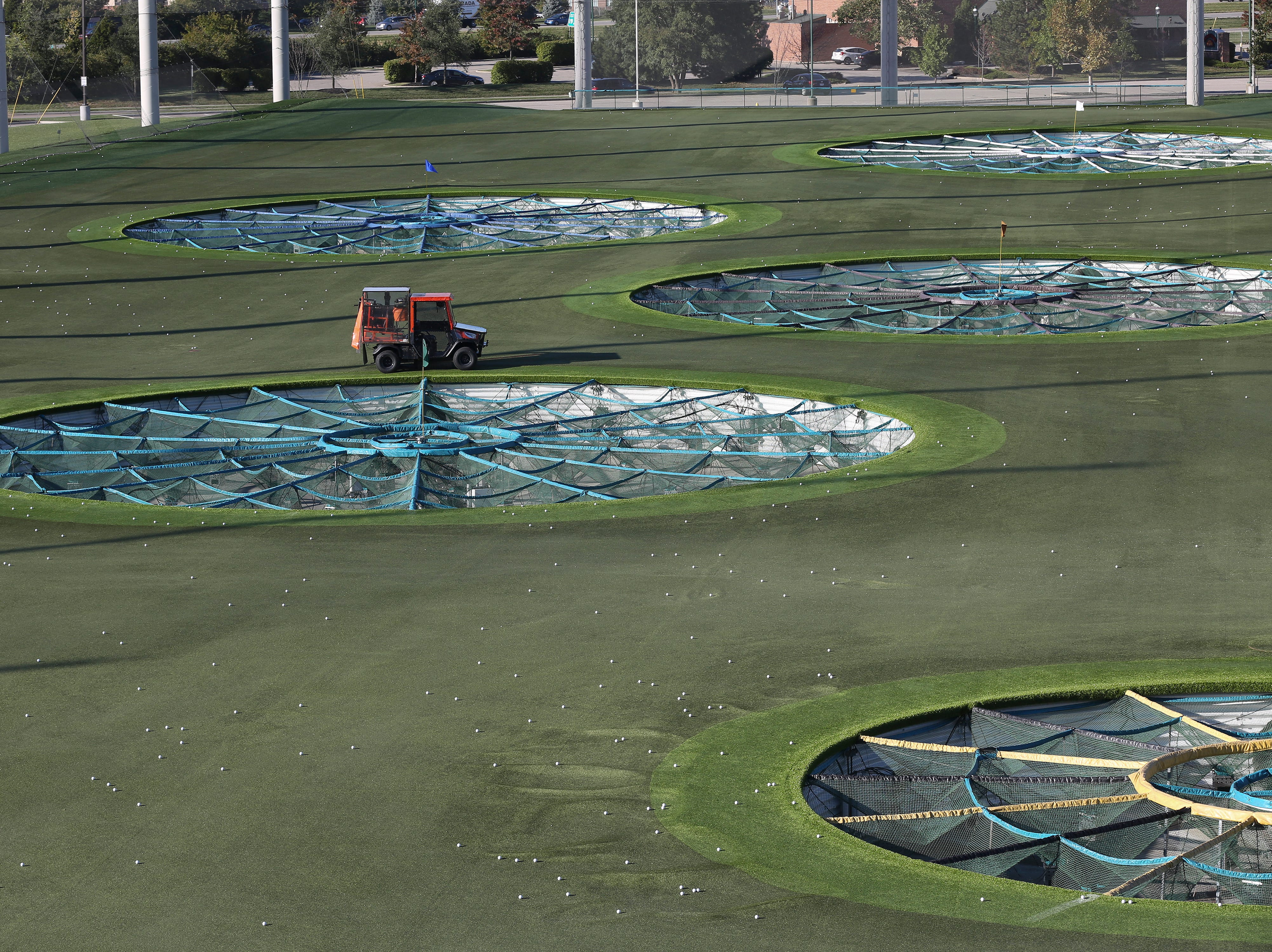 Golf balls are collected on the turf at the Topgolf outside of Cincinnati, Ohio.  Topgolf is proposing to build a facility at the Oxmoor Center in Louisville as they wait for a decision by the Metro planning commission. 