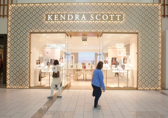 Women shopping in Oxmoor Center in Louisville, Ky., look into the Kendra Scott women's jewelry and gifts store as they pass Oct. 18, 2018.
