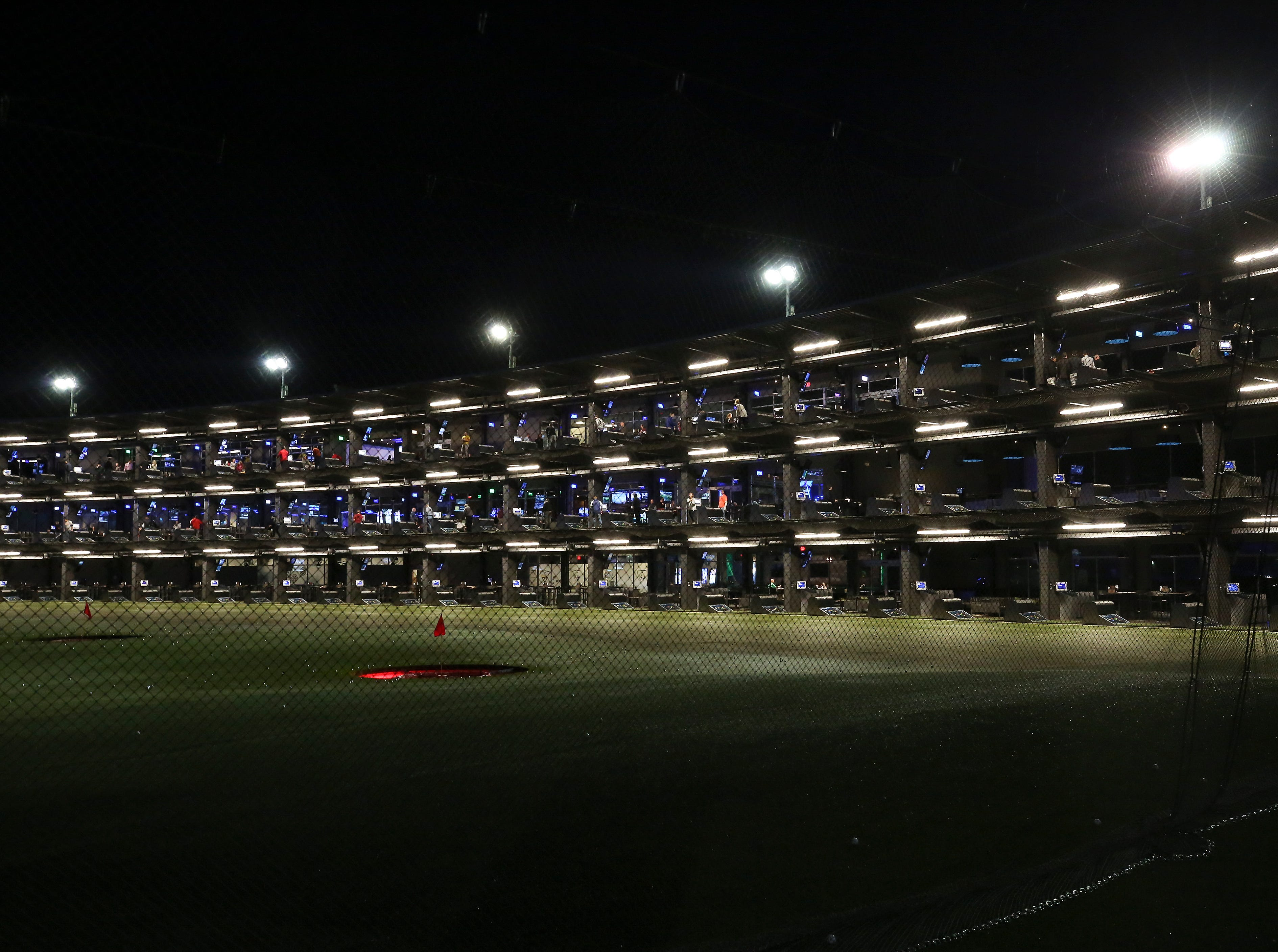 The hitting bays at the Topgolf outside of Cincinnati, Ohio.  Topgolf is proposing to build a facility at the Oxmoor Center in Louisville as they wait for a decision by the Metro planning commission. 