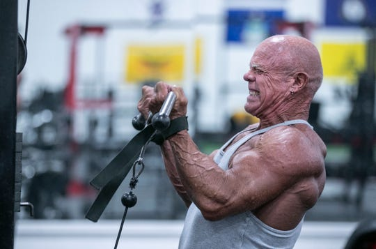 """Stan Bishop, 65, works out with weights, chin-ups and cardio frequently at The Factory Gym off Allmond Avenue in Louisville's Beechmont neighborhood. He's competed against younger men in bodybuilding categories and won. """"They don't like it when Grandpa just whipped their butt,"""" Bishop said when interviewed in 2016."""