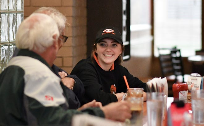 """""""She's pleasant, and always makes you feel comfortable, and she's getting her act together,"""" Douglas Love, middle, of Grand Ledge said about waitress Jesika Price, 19, of Grand Ledge, Friday, Oct. 12, 2018, at A&W in Grand Ledge."""