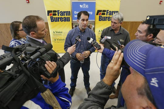 Wisconsin Gov. Scott Walker talks to reporters after receiving endorsements from Wisconsin agricultural groups at the Farm Wisconsin Discovery Center Oct. 18 in Manitowoc.