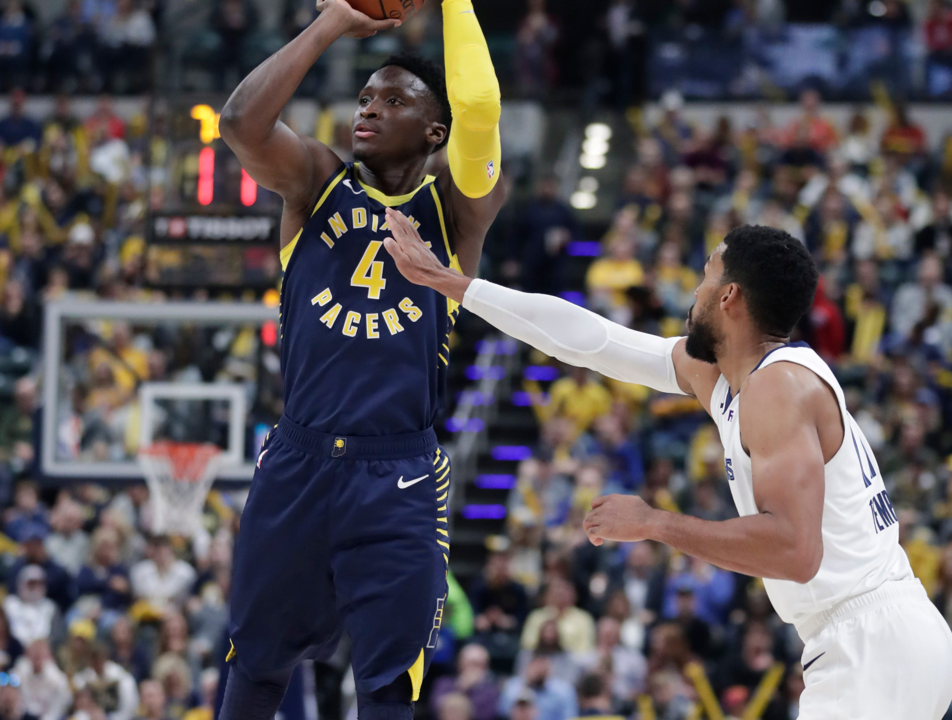Indiana Pacers guard Victor Oladipo (4) shoots over Memphis Grizzlies guard Garrett Temple (17) during the second half of an NBA basketball game in Indianapolis, Wednesday, Oct. 17, 2018. The Pacers defeated the Grizzlies 111-83.