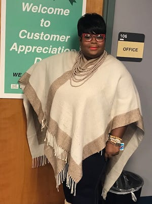 Shelisa Cox, 37, was one of the customers that the Office of Business Compliance and Diversity celebrated during its Customer Appreciation Day. The office, she said, was key in helping her to start her event planning and decorating business.