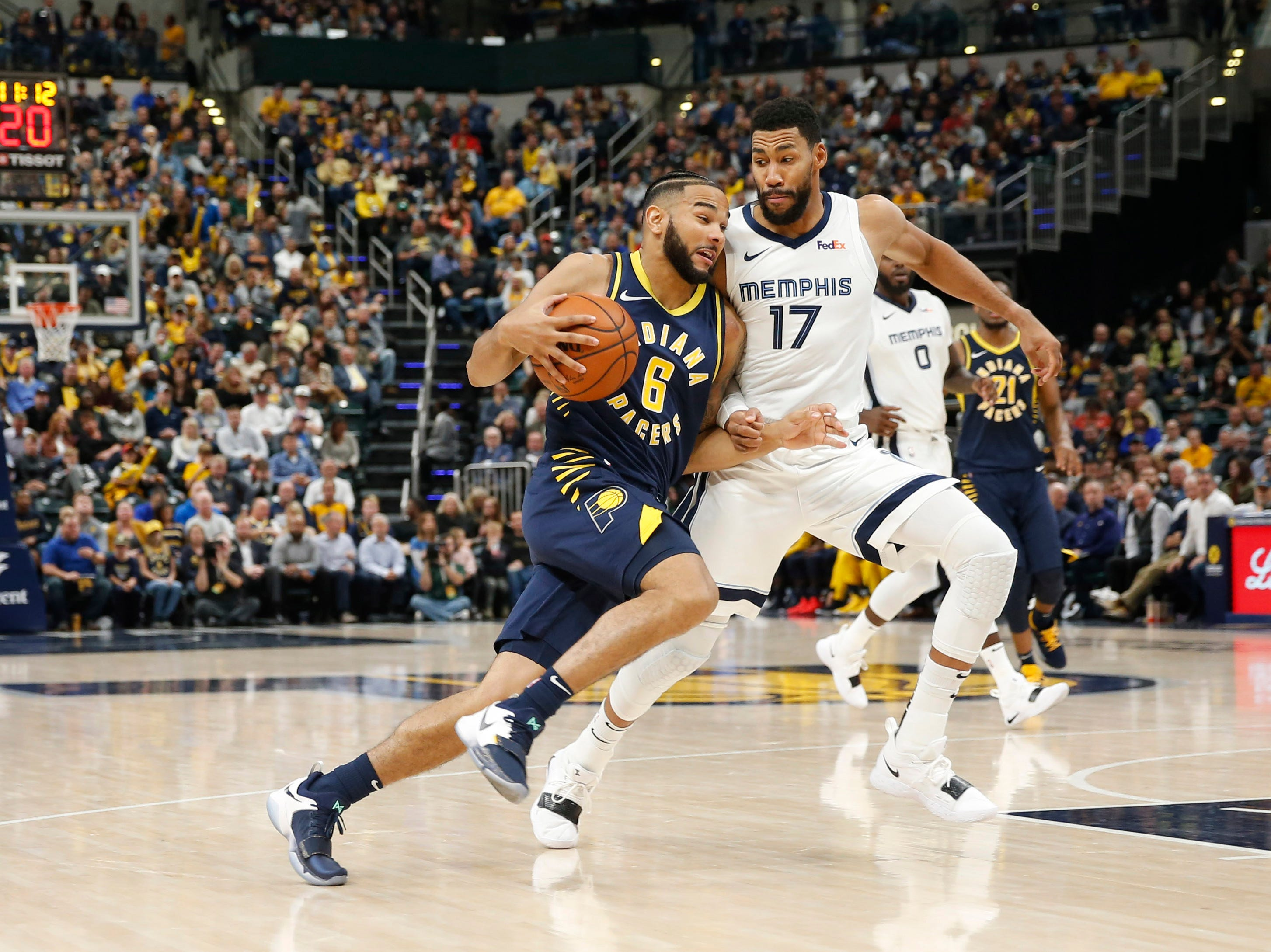 Oct 17, 2018; Indianapolis, IN, USA; Indiana Pacers guard Cory Joseph (6) drives to the basket against Memphis Grizzlies forward Garrett Temple (17) during the fourth quarter at Bankers Life Fieldhouse.