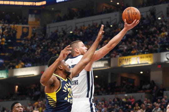 Oct 17, 2018; Indianapolis, IN, USA; Memphis Grizzlies forward Chandler Parsons (25) takes a shot against Indiana Pacers forward Thaddeus Young (21) during the first quarter at Bankers Life Fieldhouse.