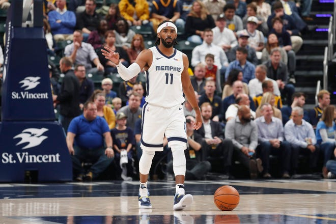 Oct 17, 2018; Indianapolis, IN, USA; Memphis Grizzlies guard Mike Conley (11) brings the ball up court against the Indiana Pacers during the first quarter at Bankers Life Fieldhouse.