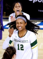 Briarcrest Christian's Alyiah Wells (12) celebrates a point against Baylor during the Championship game of the TSSAA Division II Class AA bracket of the State Girls Volleyball tournament at MTSU, on Thursday, Oct. 18, 2018.
